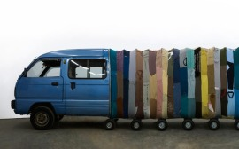 Yin Xiuzhen. Collective Subconscious. 2007. Minibus, stainless steel, used clothes, stools, music.