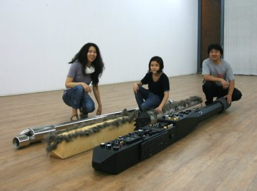 "The Song family with their respective chopsticks for the piece ""Third Chopstick"" 2013."